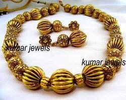 ethnic gold plated mala