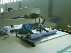 Cotton Roll Cutting Machine