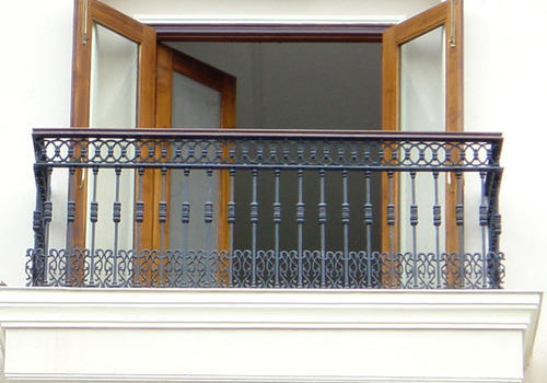 Balcony window grills casting balcony grill for Balcony railing designs pictures