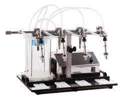Semi Automatic Twin Head Vacuum Filling Machine