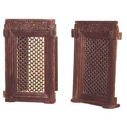 wooden carved windows with iron grills