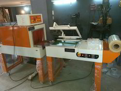 L Sealer with Automatic Take UP Conveyor