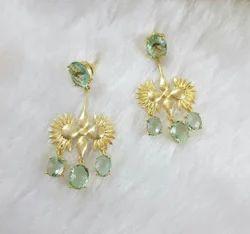 Gold stone earring.