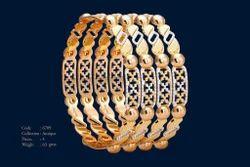 Manufacturer of Designer Gold Bangles & Fancy Gold Bangles