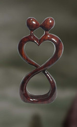 Wood Sculpture Of A Man & A Woman In An Intimate Moment