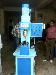 Reviting Machine