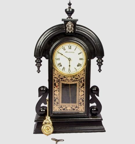 Old wall clocks with pendulum