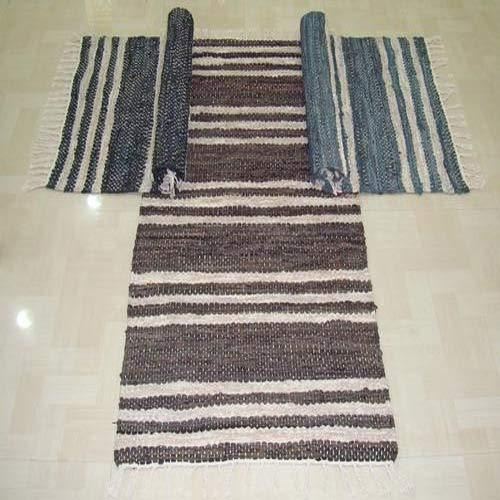 Striped And Leather Rugs View