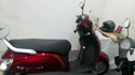 Red Access Suzuki Scooter