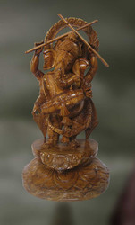 Wood Sculpture Of Lord Ganesha Playing Drum