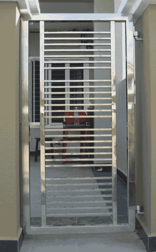 Safety doors glass panel wrought iron safety door grill for Ss door design
