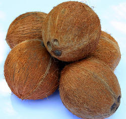 Fully Husked Coconuts.