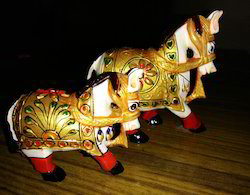 Gold and White Wooden Horse