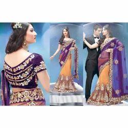 Triveni Bright Purple Orange Net Lehenga Saree