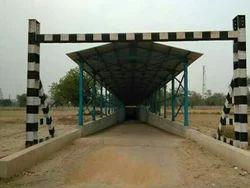 Railway under pass roof sheet installation.