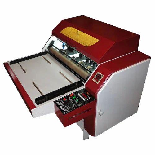 Sticker scoring machine