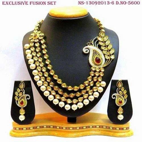 Kundan set  Kundan necklace set  Vilandi Kundan set  Simple Kundan set with ruby tumble drops  Indian wedding set  Kundan jewellery set