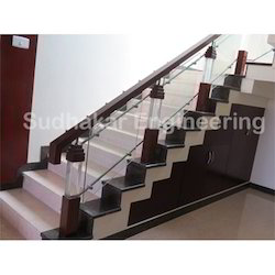 Solid Glass Pillars and Wooden Handrails